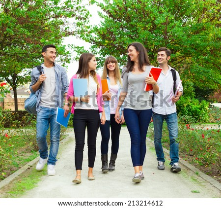Group of students going to school - stock photo