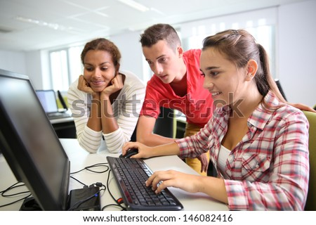 Group of students in computer's laboratory - stock photo