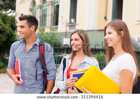 Group of students in front of their school - stock photo