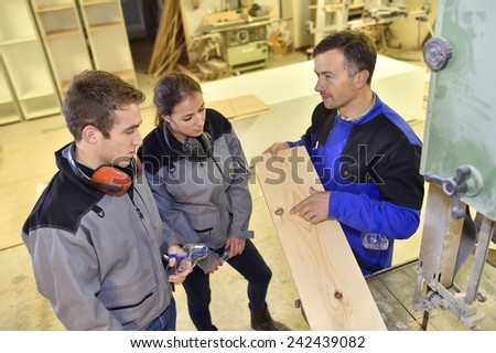 Group of students in woodwork training course  - stock photo