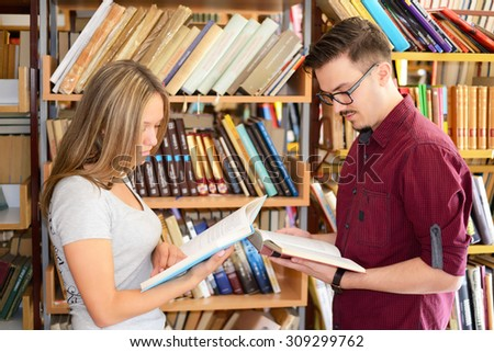 Group of students learning in the library and enjoy - stock photo