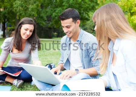 Group of students outdoors - stock photo