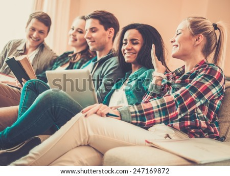 Group of students preparing for exams in apartment interior  - stock photo