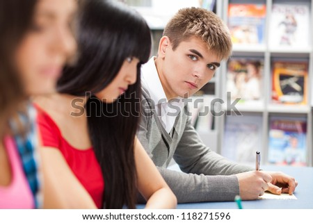 Group of students sitting in a classroom - stock photo
