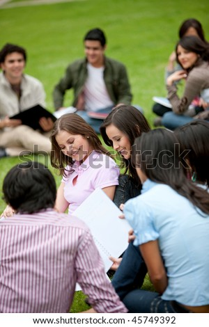 Group of students sitting outdoors and smiling