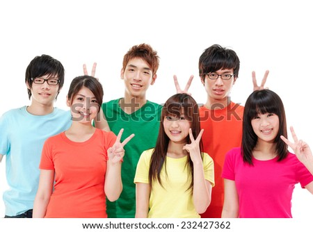 Group of students smiling and doing victory sign - stock photo