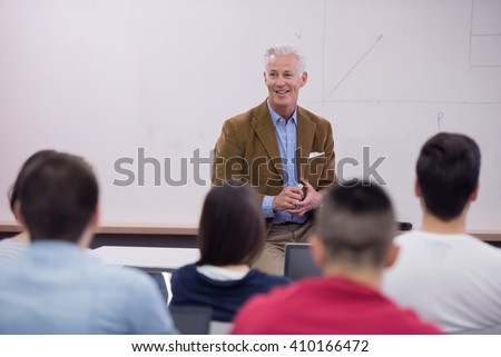 group of students study with professor in modern school classroom - stock photo