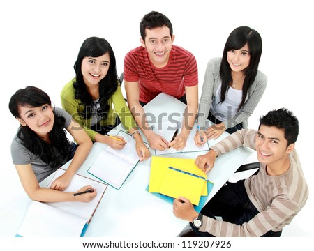 Group of students studying together seen from above - stock photo