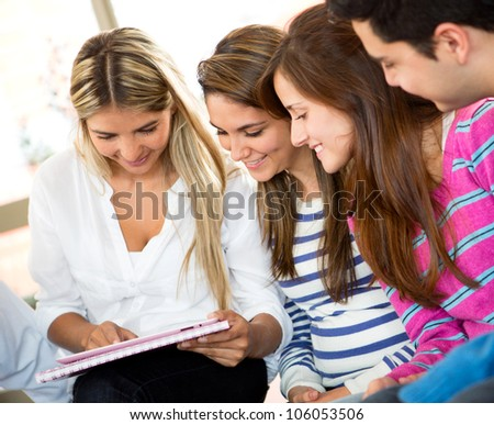 Group of students using a tablet computer in class - stock photo