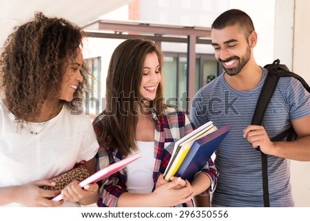 Group of students walking in University Campus - stock photo