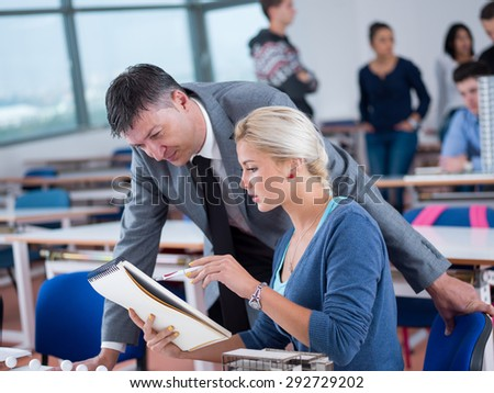 group of students with teacher in computer lab classroom learning lessons,  get help and support - stock photo