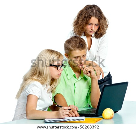 Group of students with the laptop solve a problem