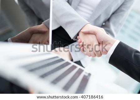 Group of success business people team shake hands in office with city background and computer, asian - stock photo