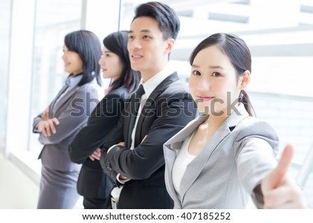 Group of success business people team show thumb up in office, asian - stock photo
