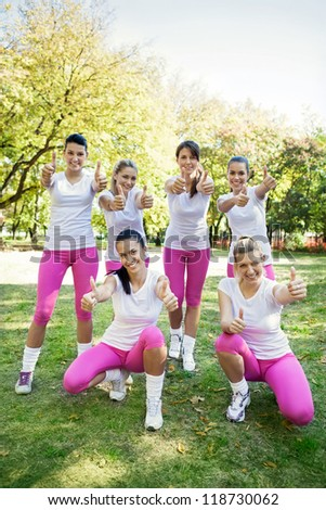 Group of success sporty women with thumbs up - stock photo