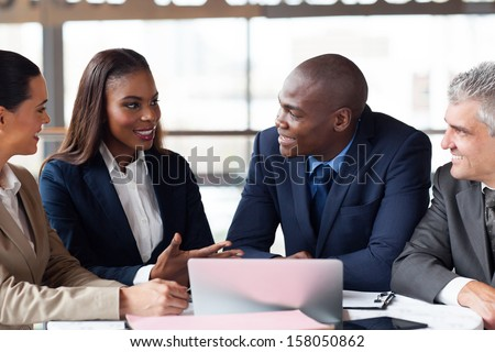 group of successful business people having meeting together - stock photo