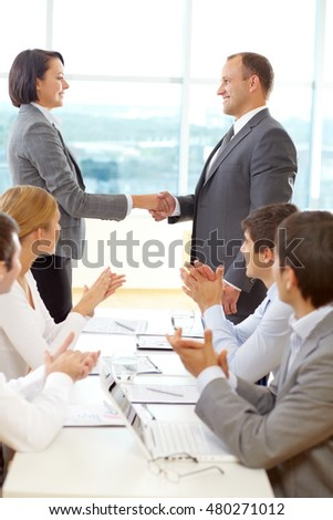 Group of successful business people making a business deal at a meeting