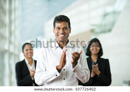 Group of successful Indian business people clapping good news