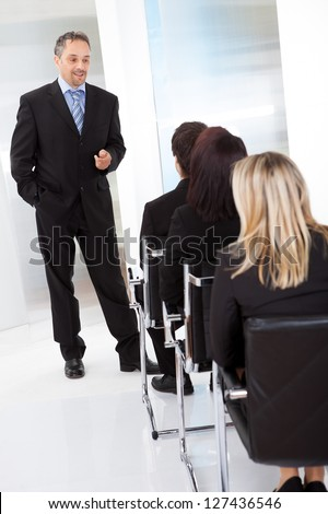 Group of successfull business people at the lecture - stock photo