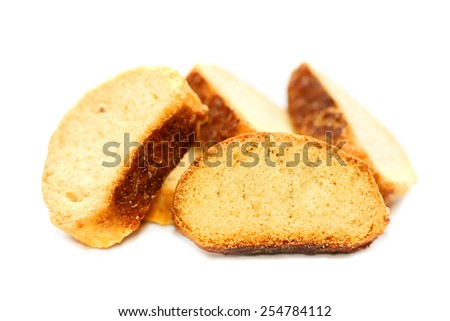 group of sweet tasty rusks isolated on white background - stock photo