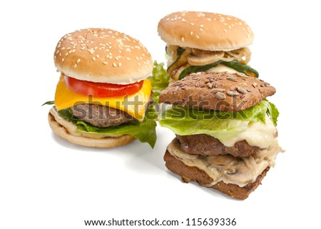 group of tasty fresh cheeseburgers isolated on white background