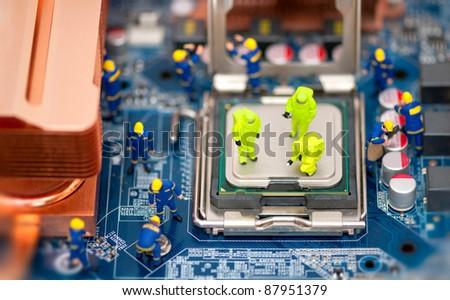Group of technicians repair computer. Computer repair concept - stock photo