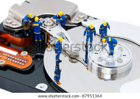 Group of technicians repair hard drive - stock photo
