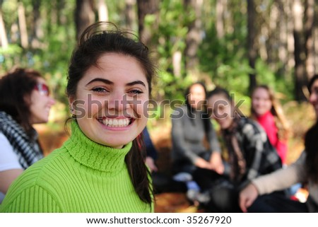 group of teen girls on vacation during a trip in the forest - stock photo