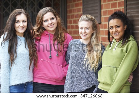 Group Of Teenage Female Friends In Urban Setting