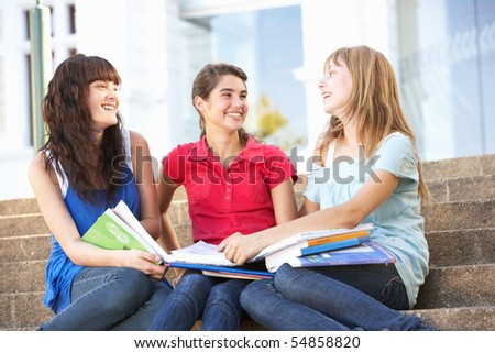 Group Of Teenage Female Friends Sitting On College Steps Outside - stock photo