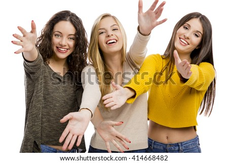 Group of teenage friends with arms open