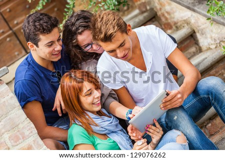 Group of Teenage Friends with Tablet PC - stock photo