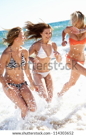 Group Of Teenage Girls Enjoying Beach Together - stock photo