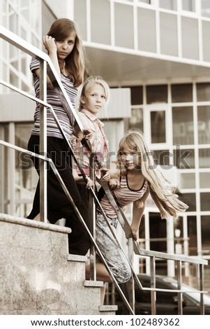 Group of teenage girls on the steps - stock photo