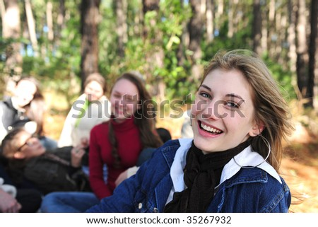 group of teenage girls on vacation during a trip in the forest - stock photo