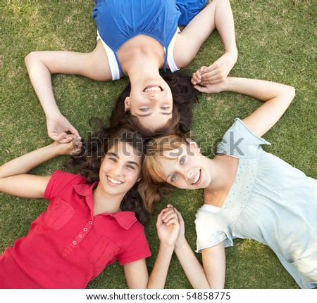 Group Of Teenager Girls Looking Up Into Camera - stock photo