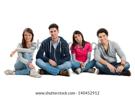 Group Of Teenager Isolated Sitting On White Background  - stock photo