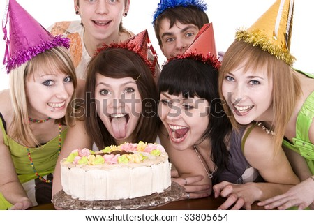 Group of teenagers celebrate happy birthday. Isolated. - stock photo