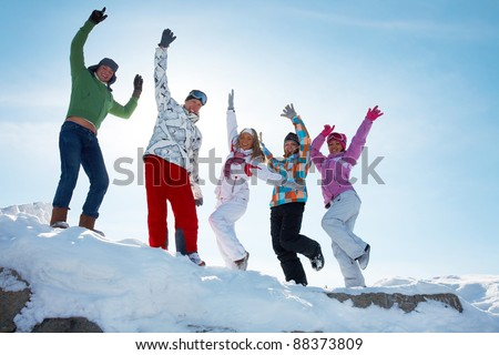 Group of  teenagers dansing together in wintertime - stock photo