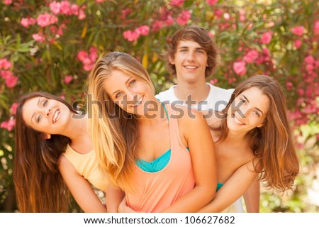 Group of teenagers enjoying at the park - stock photo