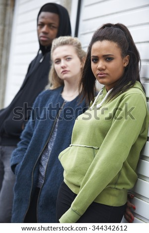 Group Of Teenagers Hanging Out In Urban Environment - stock photo