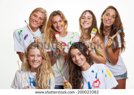 group of teenagers having fun with paint - stock photo