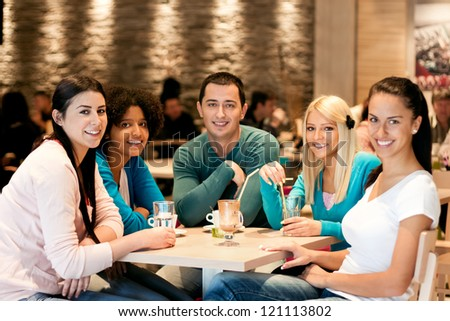 Group of teenagers in cafe, students leisure activities leisure activities - stock photo