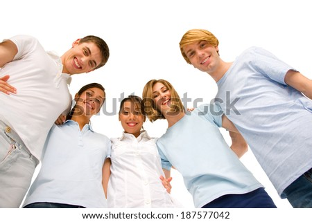 group of teenagers in huddle - stock photo