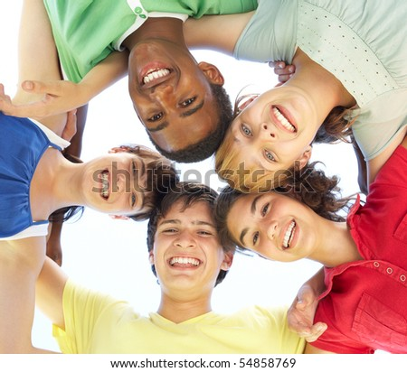 Group Of Teenagers Looking Down Into Camera - stock photo