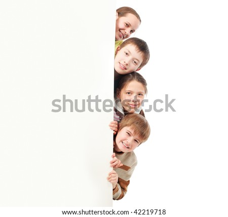 Group of teenagers looking out white board. - stock photo