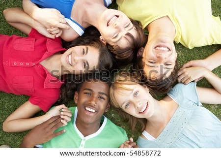 Group Of Teenagers Looking Up Into Camera - stock photo