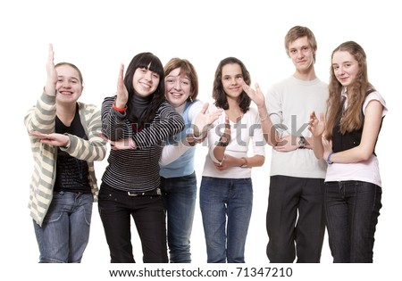 Group of teenagers pull hands that them have seen