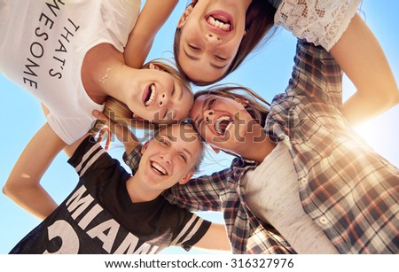 Group of teenagers staying together looking at camera - stock photo