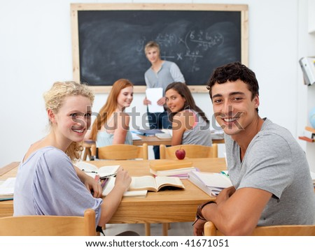 Group of teenagers studying together in a class - stock photo